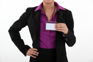 Woman holding a blank name tag