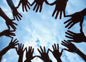 circle of volunteers hands